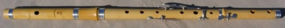 [photo of a 5-key european boxwood Irish flute with tuning slide and silver rings]